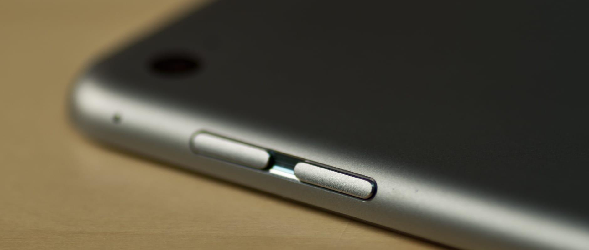 A photograph of the Apple iPad Air 2's volume rocker.