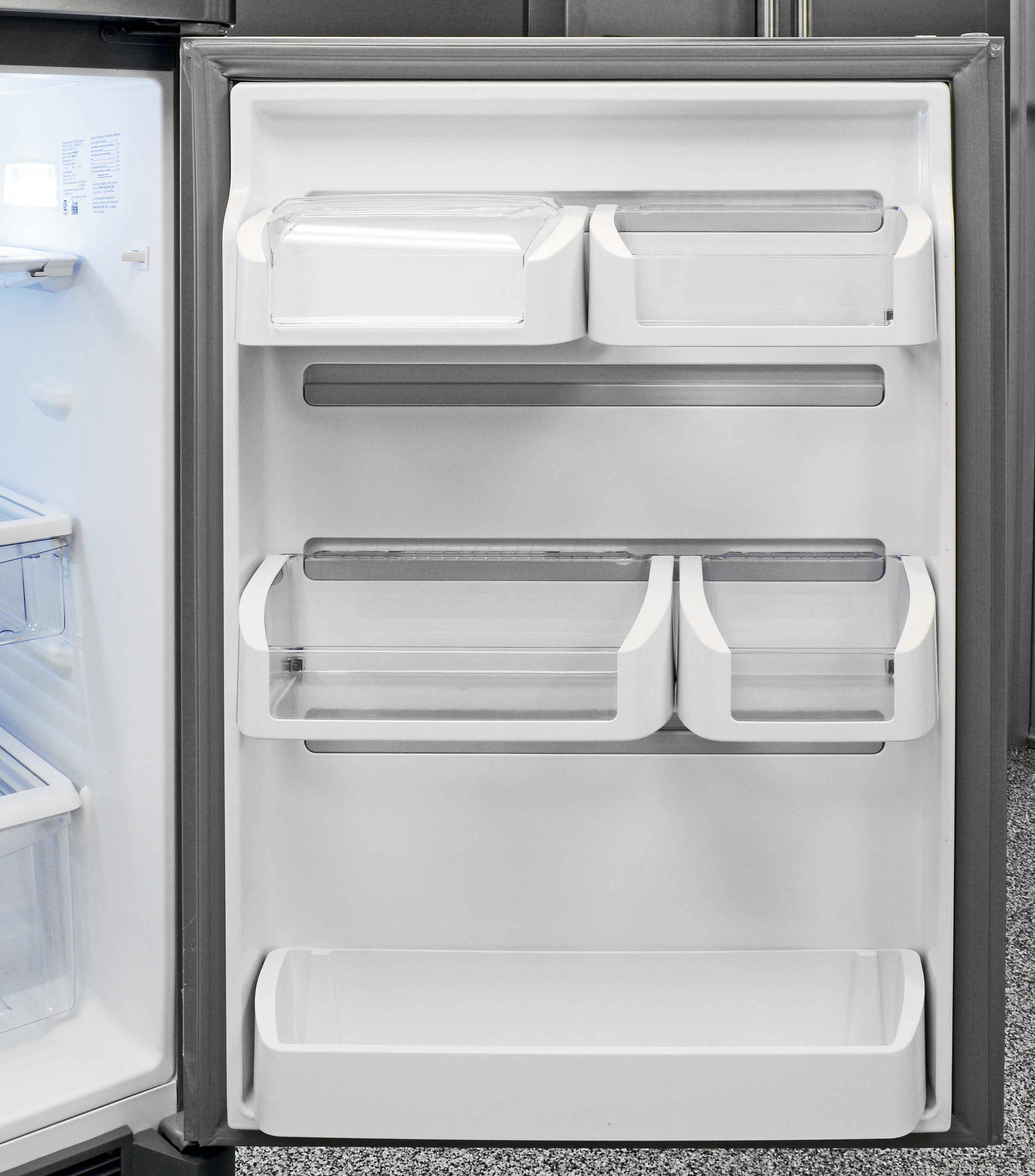 You can leave the Frigidaire Gallery FGHT2046QF's door shelves in a traditional layout as seen here, or you can mix and match levels, allowing you to slide the buckets left and right on gray plastic runners.