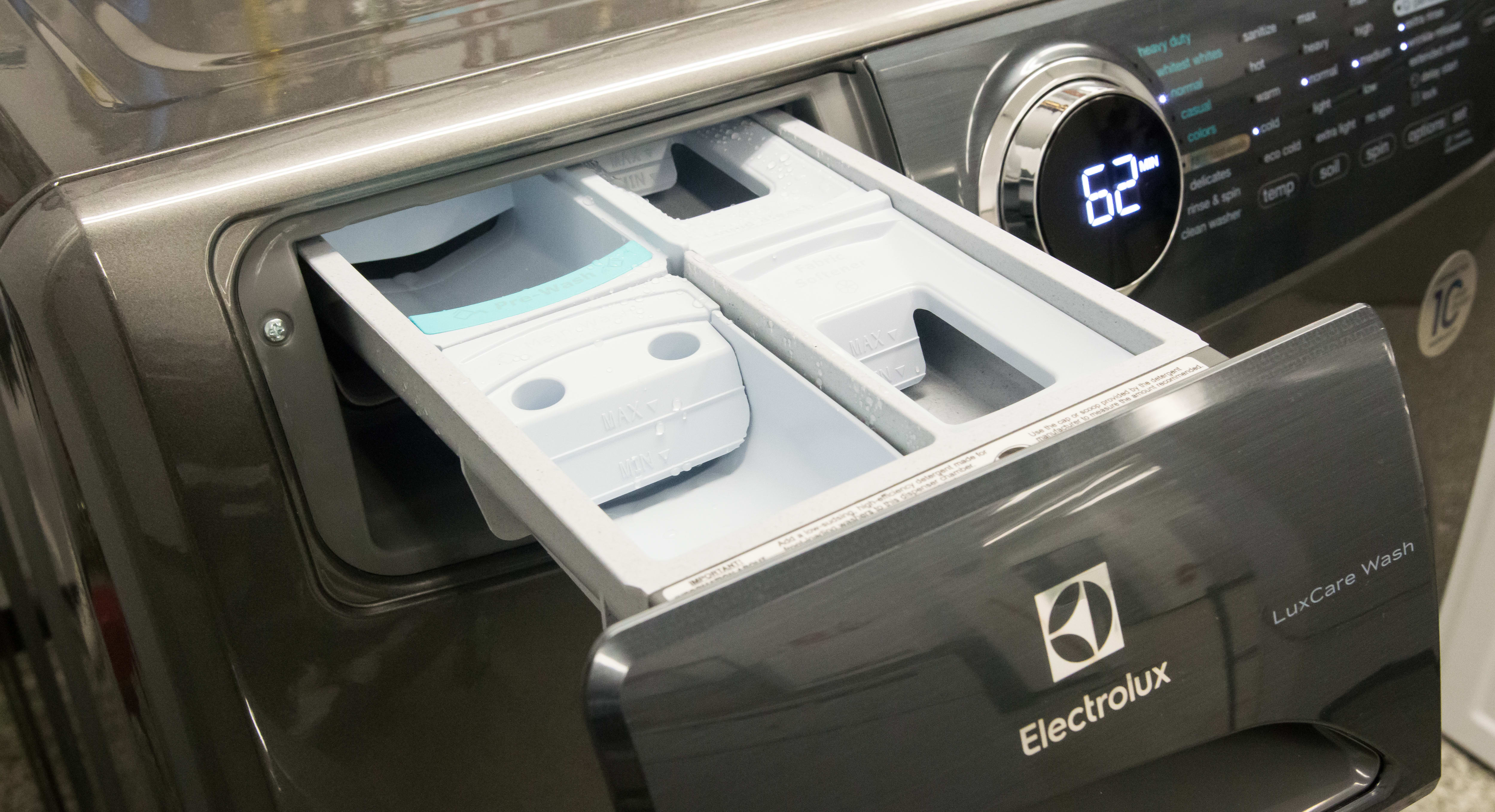 The detergent dispenser, with separate sections for softener, bleach, and pre-wash.