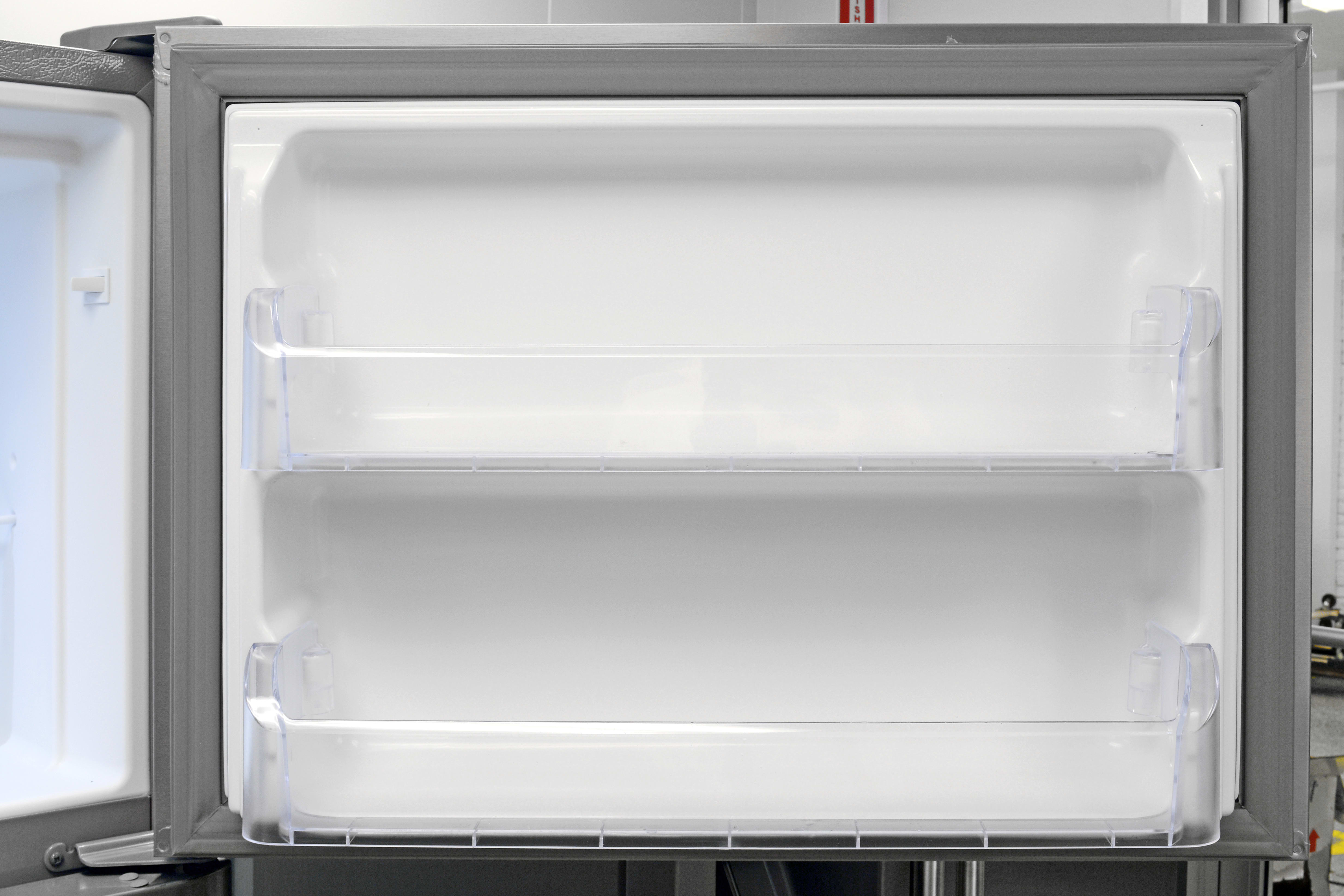 Freezer door storage in the Frigidaire Gallery FGHT2046QF? A pair of matching shelves that don't move.