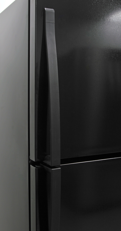 Unlike the smooth, glossy doors, the Whirlpool WRT318FZDB's plastic handles feel decidedly cheap.