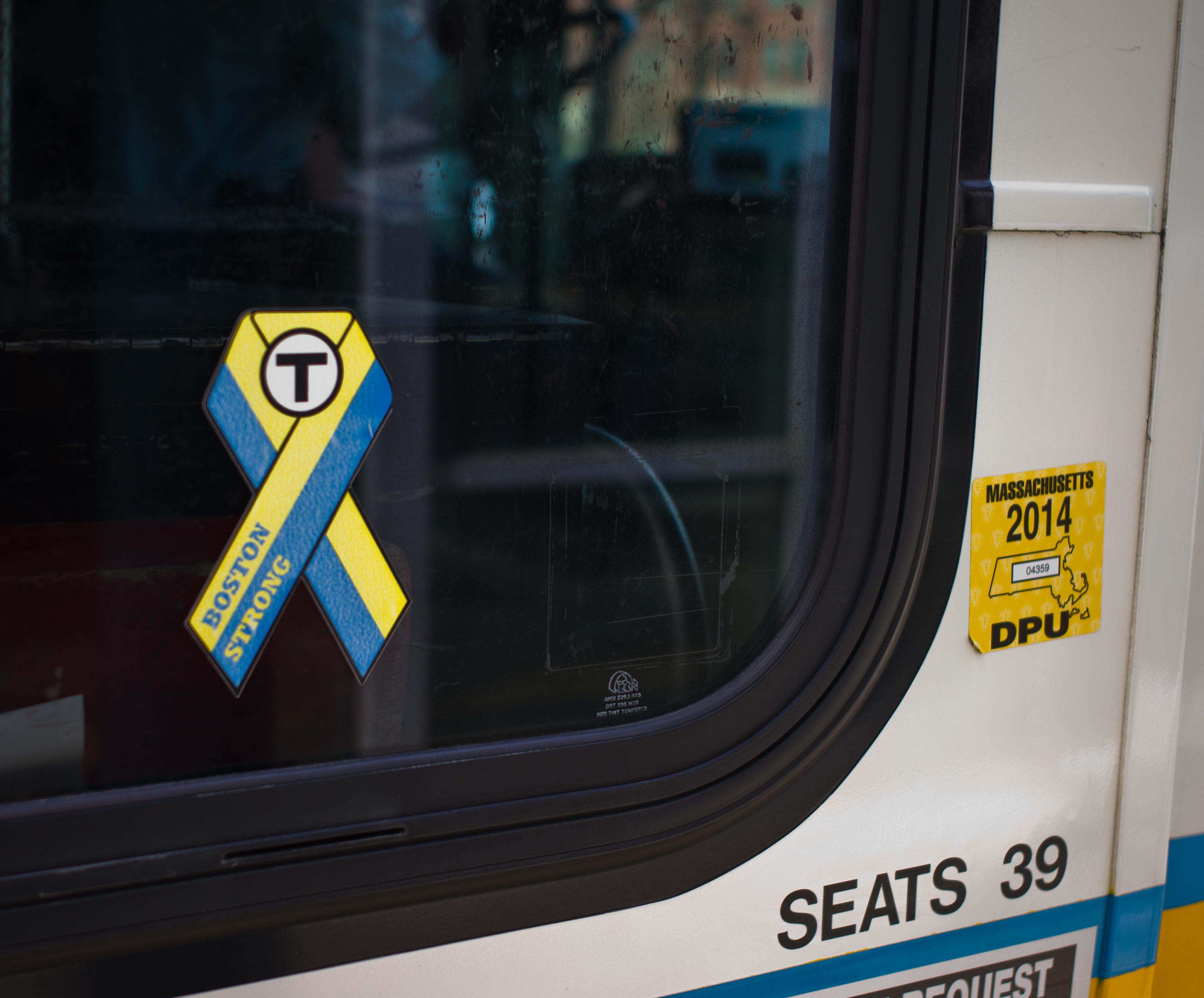 A shot of a sticker on a local MBTA bus.
