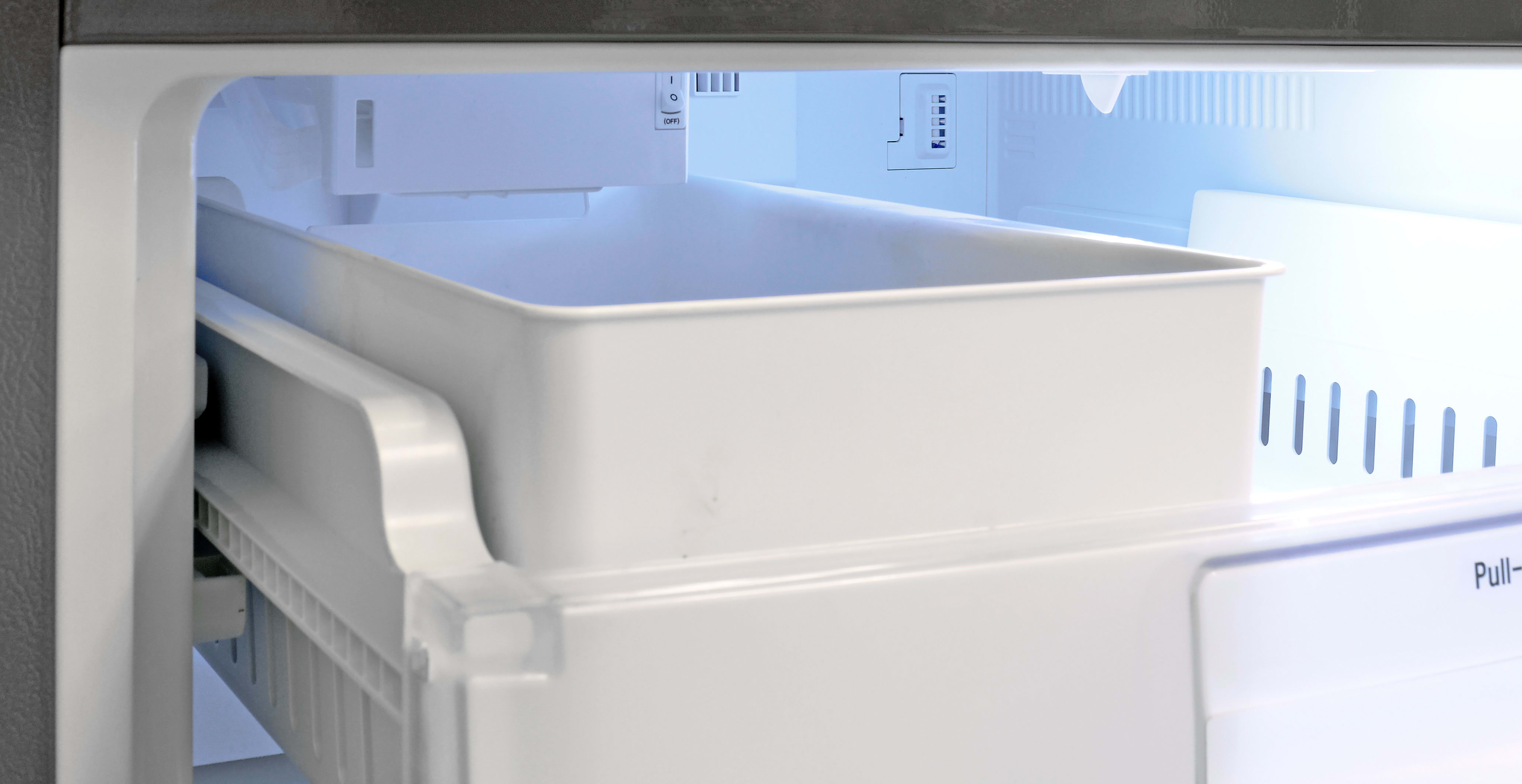 The LG LDCS24223S's unobtrusive ice maker is found tucked away into the ceiling of the freezer. There's a basic on/off switch that turns it... well, on or off.