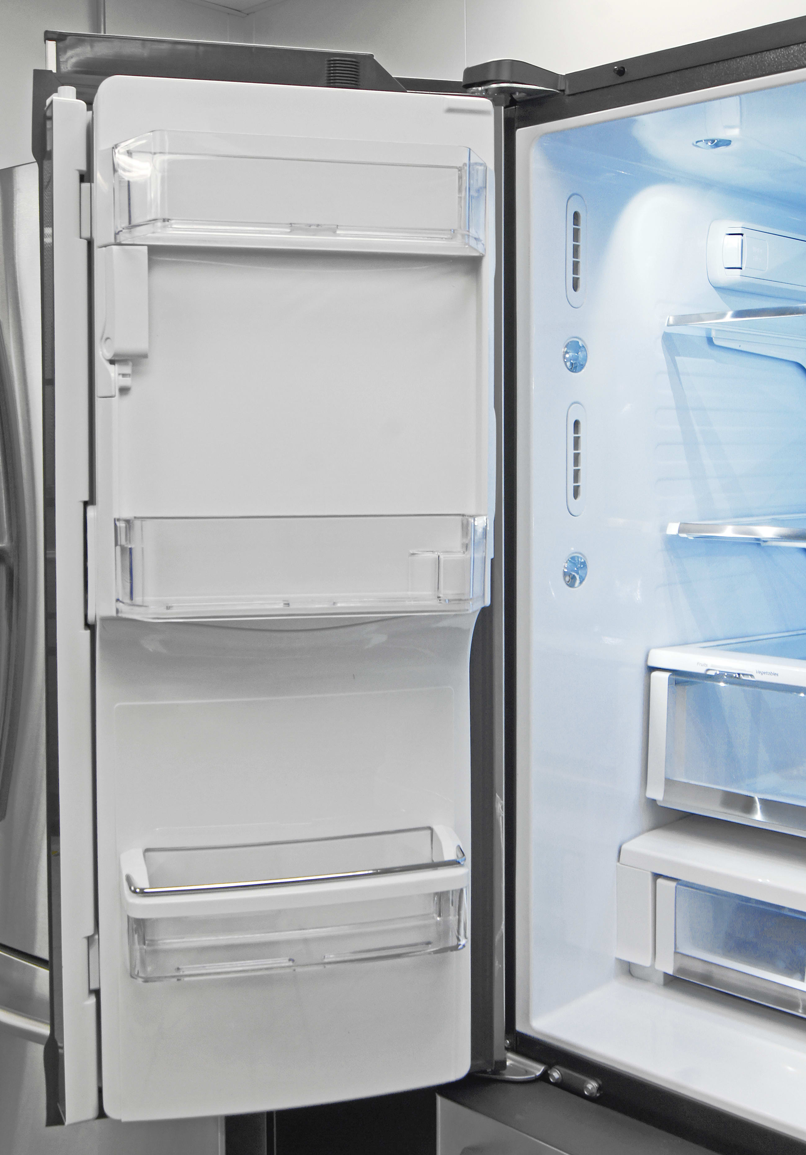 The GE Cafe CFE28TSHSS's door-mounted icemaker necessitate shallow shelves on the left.