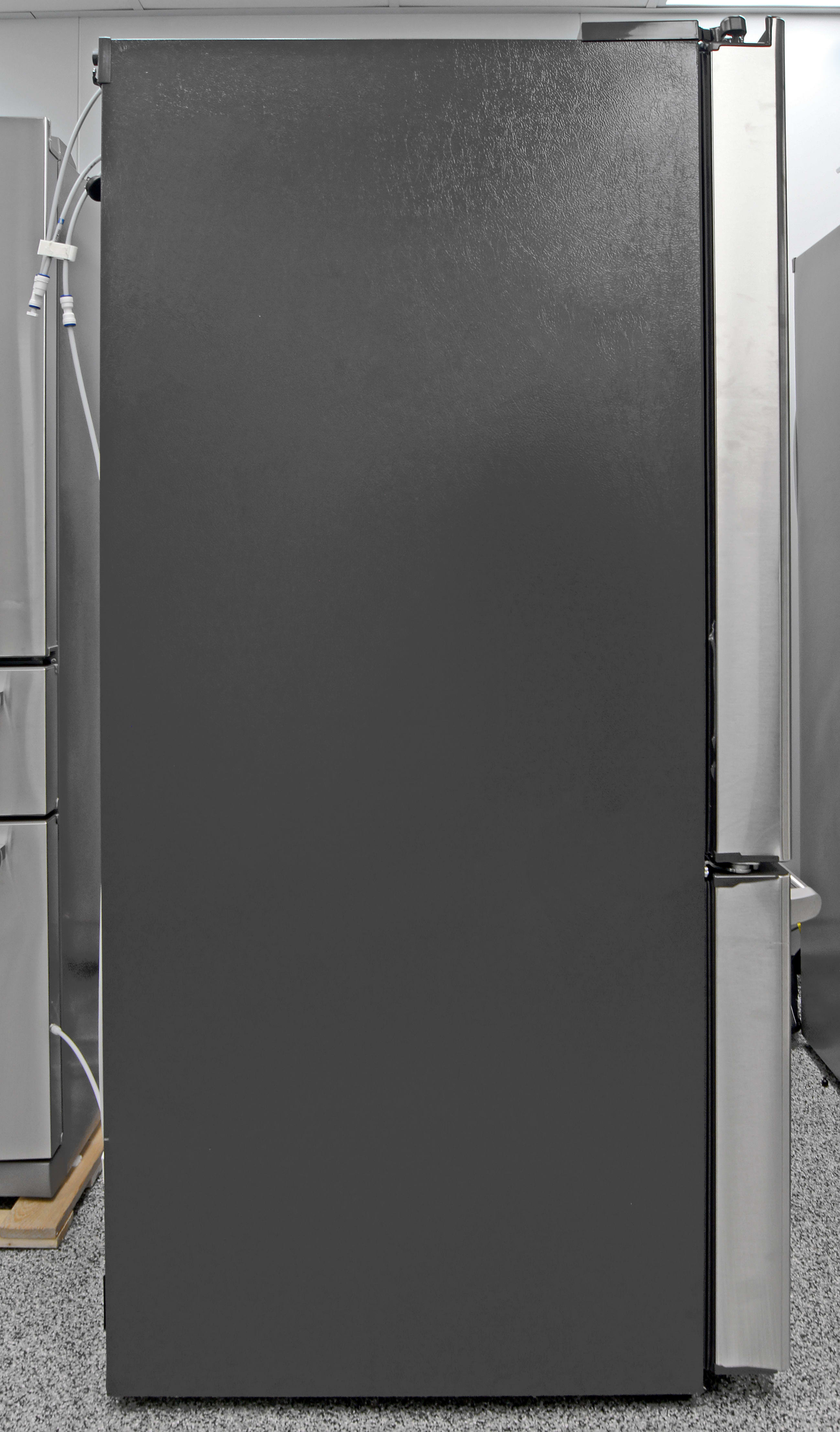 The sides of an expensive fridge normally complement the front finish, but the GE Cafe CFE28TSHSS's dark grey sides are a surprising contrast.