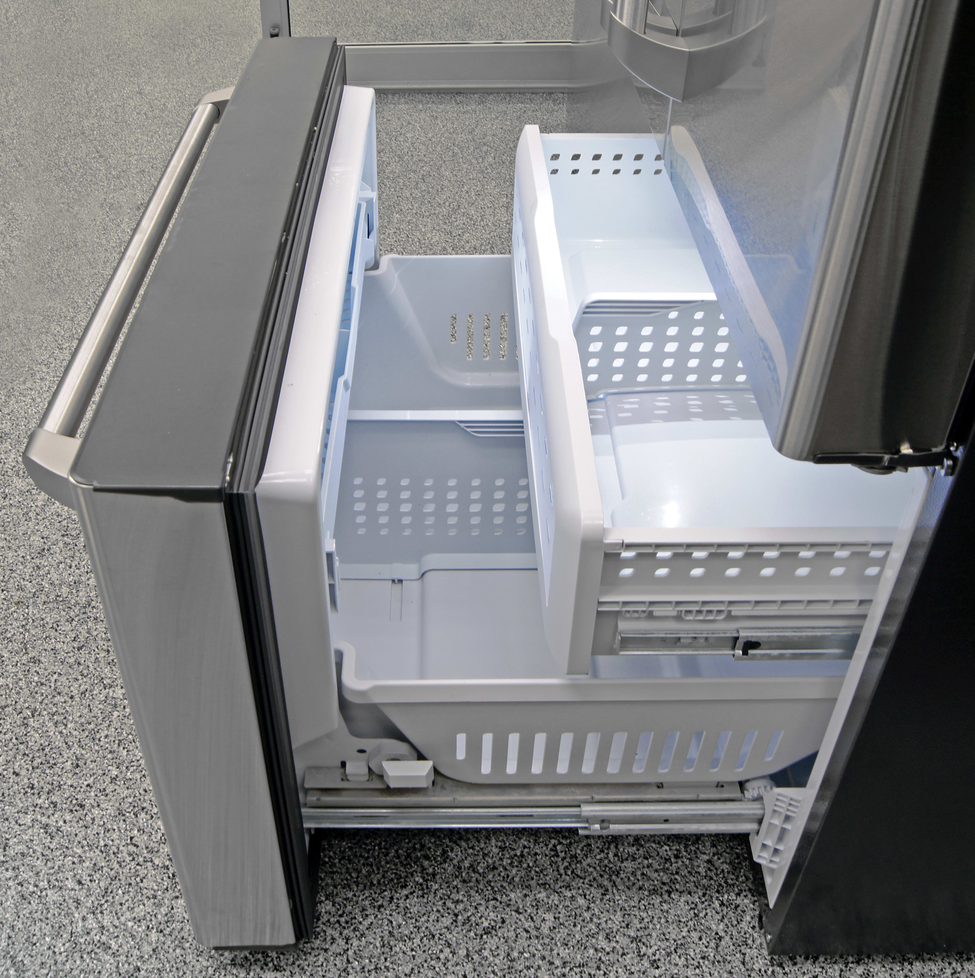 The GE Cafe CFE28TSHSS's pull-out freezer is low-tech, very roomy, and great at chilling food.