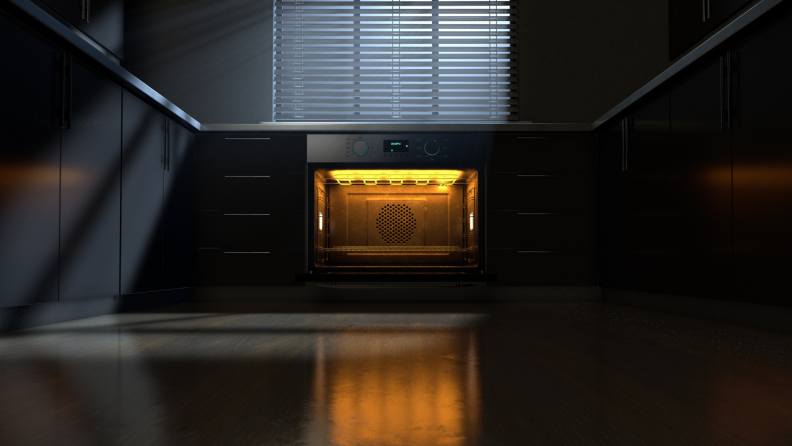 Open oven with lights on at a distance in a kitchen at night