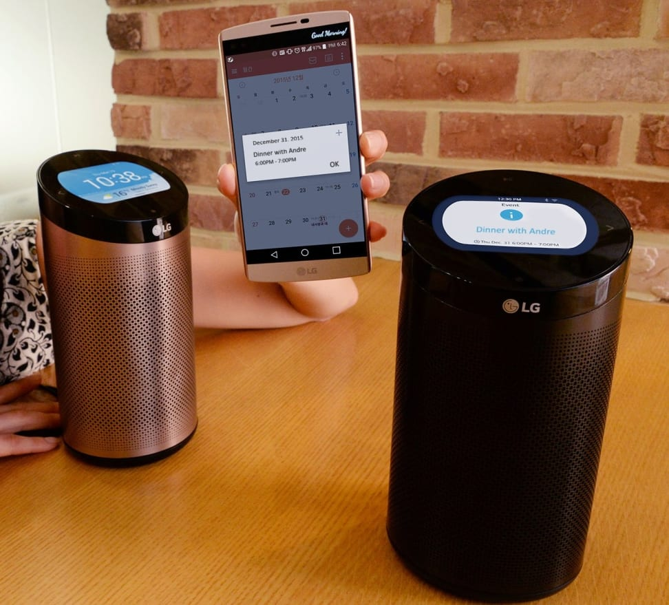 Two LG SmartThinQ hubs with a smartphone