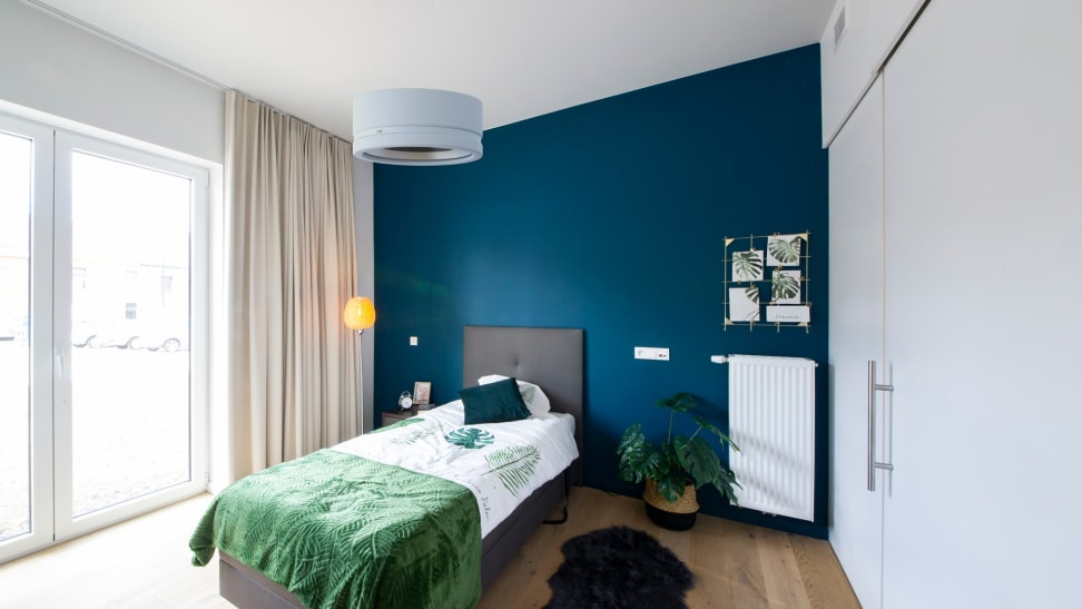 Bedroom with Nobi lamp hanging from ceiling