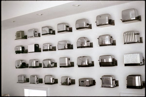 a collector's wall of vintage toasters