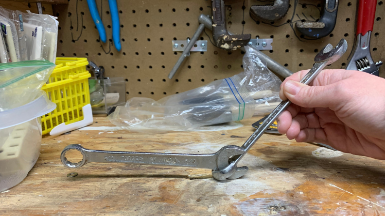 When trying to break a bolt loose, gain leverage is by linking combination wrenches.
