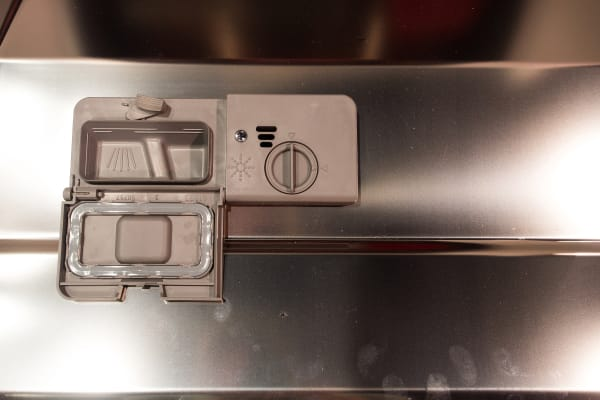 The detergent dispenser inside the Smeg retro dishwasher