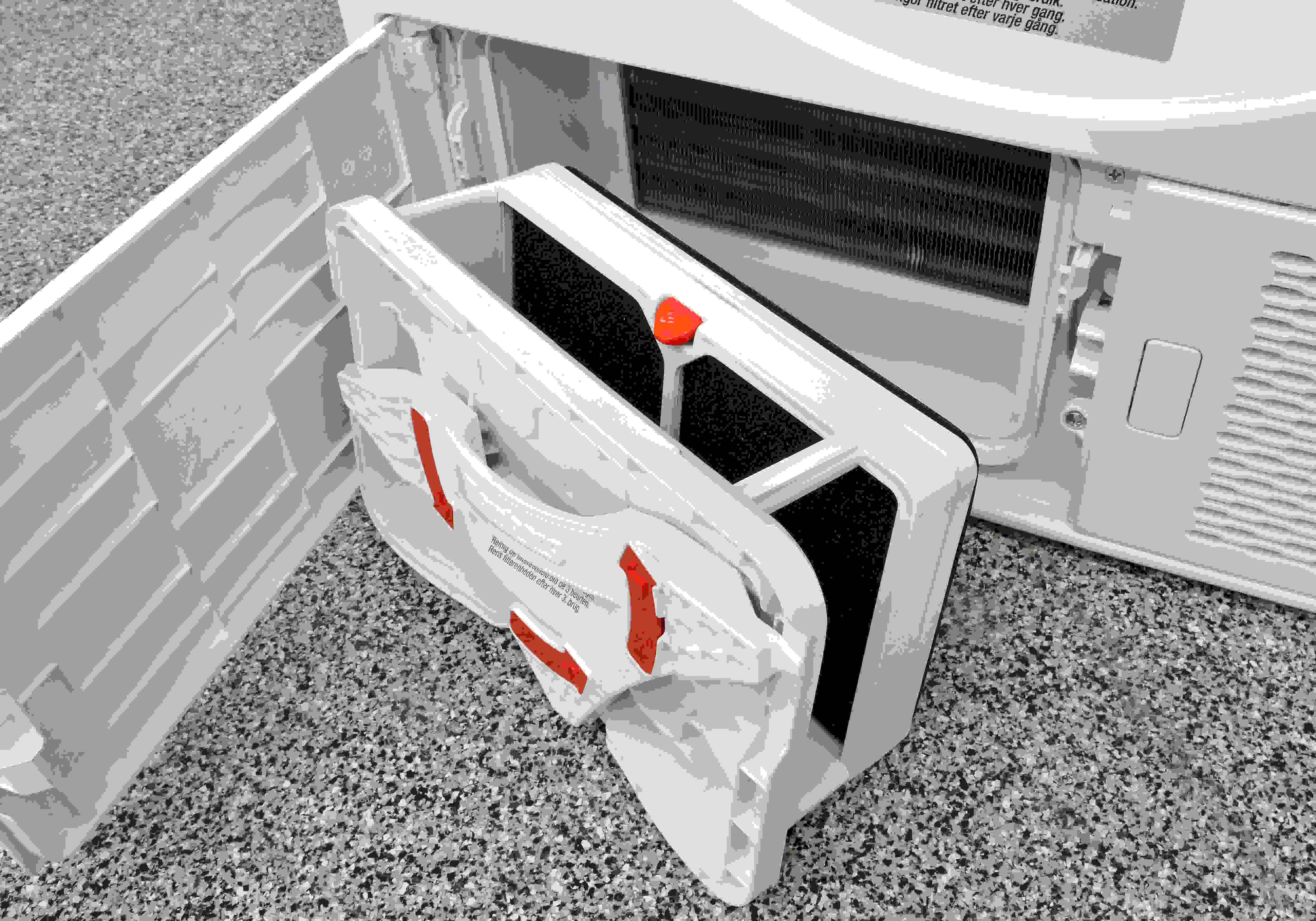 The Blomberg DHP24412W's secondary lint trap is used to help filter out particles from the water circulating through the dryer.