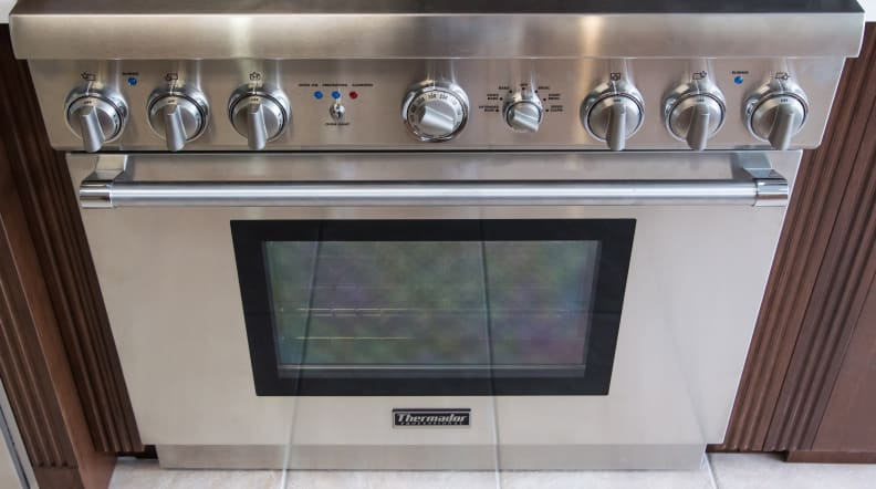 Oven, controls, and handle