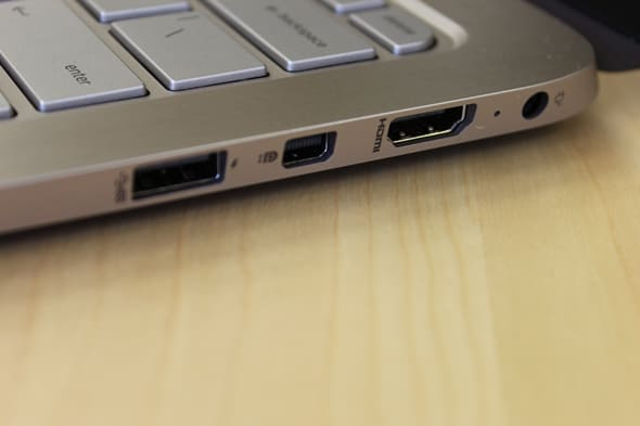 The Spectre's right side has a USB 3.0 slot, a DisplayPort, an HDMI output, and a power input.
