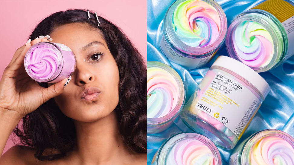 On the left: A woman staring at the camera and holding the Truly Beauty Acai Your Boobies Lifting Boob Polish in front of her eye. On the right: Several jars of the Unicorn Fruit Whipped Body Butter lay on a satin blue sheet with one laying with the label out toward the camera.
