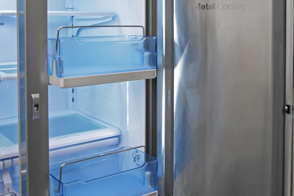 The Samsung RF23HTEDBSR's two larger bucket shelves can slide out for easier access.