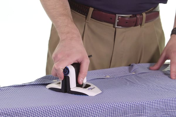 The Collar Perfect can be unfolded and uses as a conventional iron, as well.