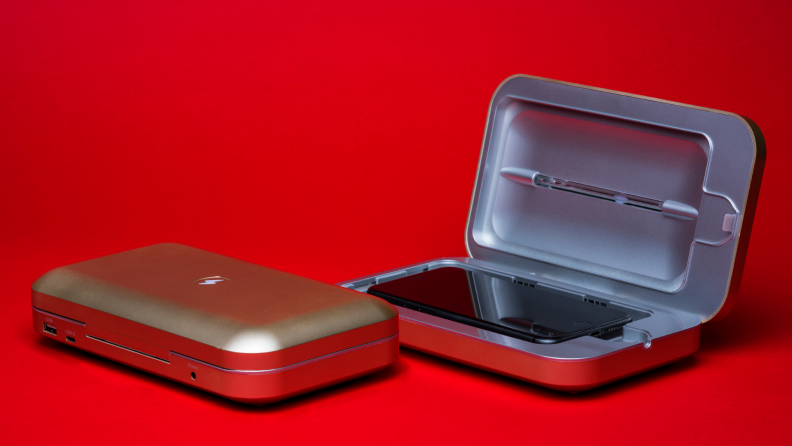Phone sanitizing product on a red backdrop