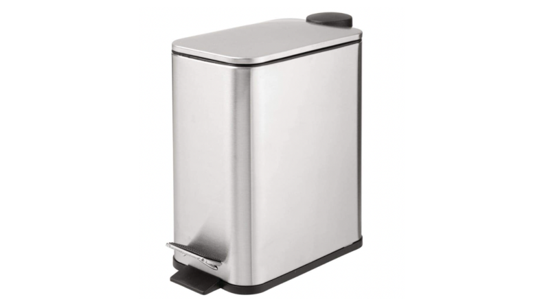 A silver trash can with a step feature for hands-free opening.
