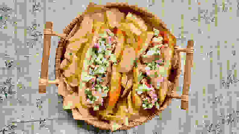 In the center of the image, two lobster rolls were surrounded by Cape Cod Kettle Cooked Potato Chips in a wicker tray.