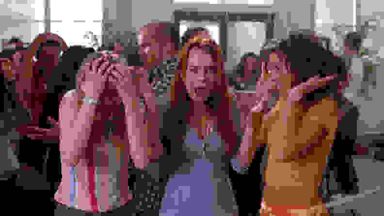 Cady (Lindsay Lohan), Karen (Amanda Seyfried), and  Gretchen (Lacey Chabert) being doused by a fire extinguisher.