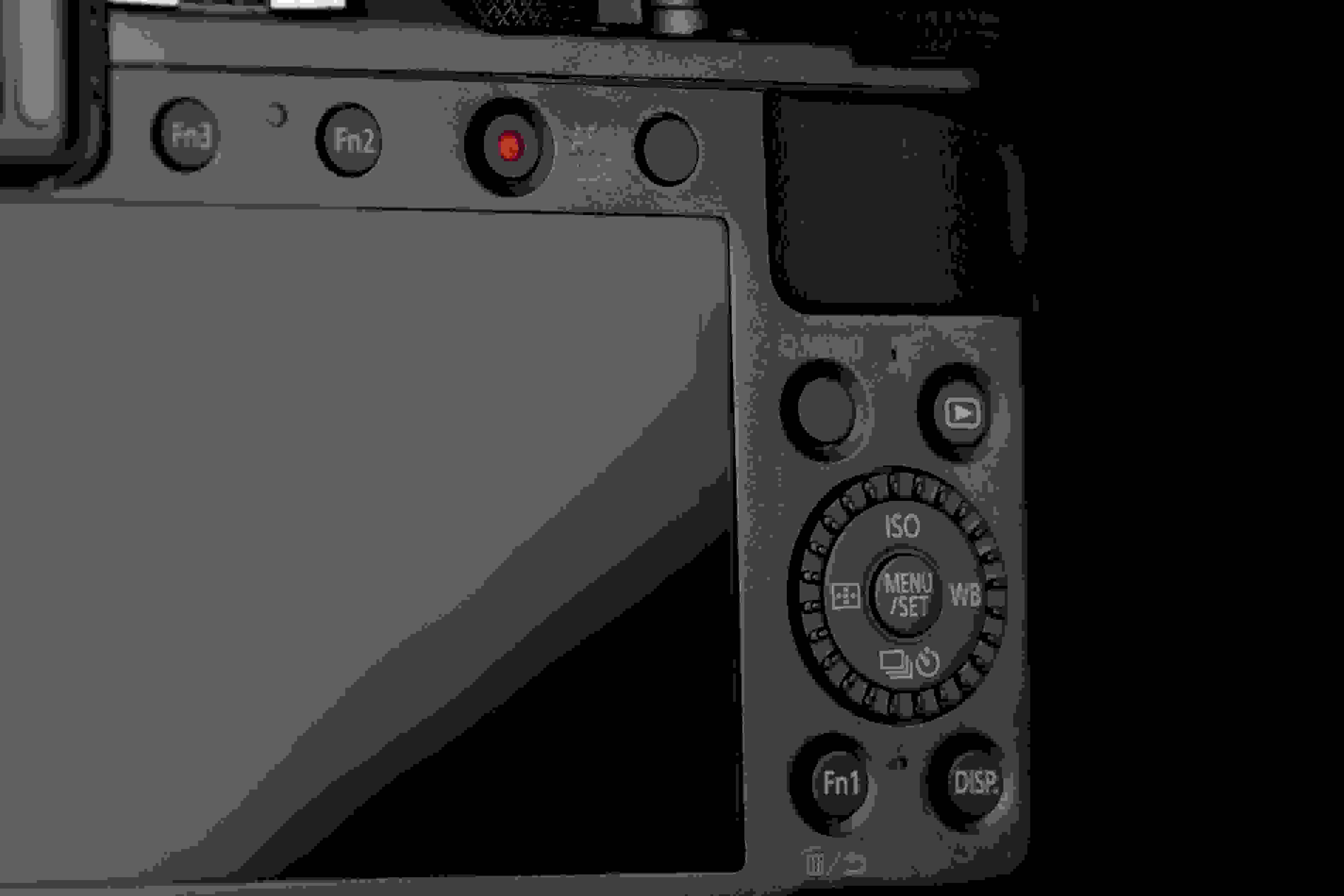 A photograph of the Panasonic Lumix LX100's rear controls.