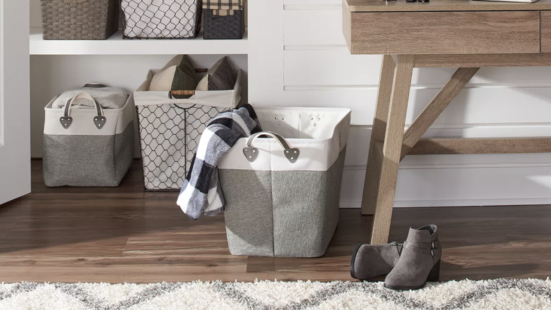 A room with a storage basket on the floor