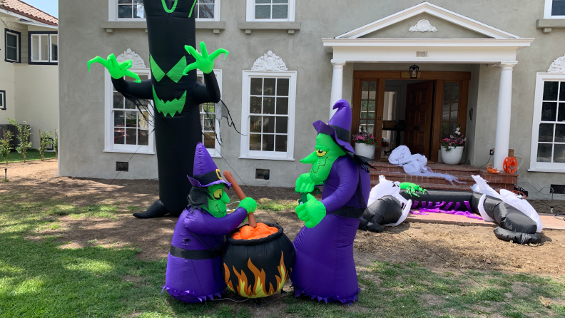 Halloween inflatables on a front lawn of a house