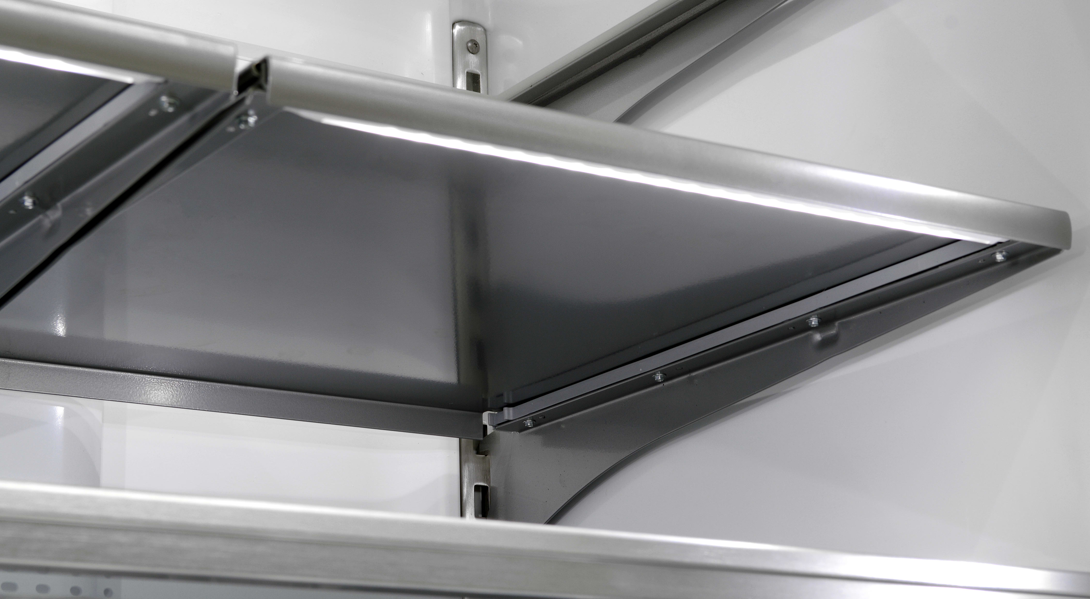 To deal with the opaque design, both of the Maytag MFX2876DRM's stainless shelves have built-in LED lights just underneath their front edges.