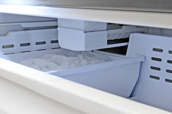 The Samsung RF260BEAESR's actual ice maker is tucked away more or less out of reach. You can turn it on or off using the central control panel up in the fridge.