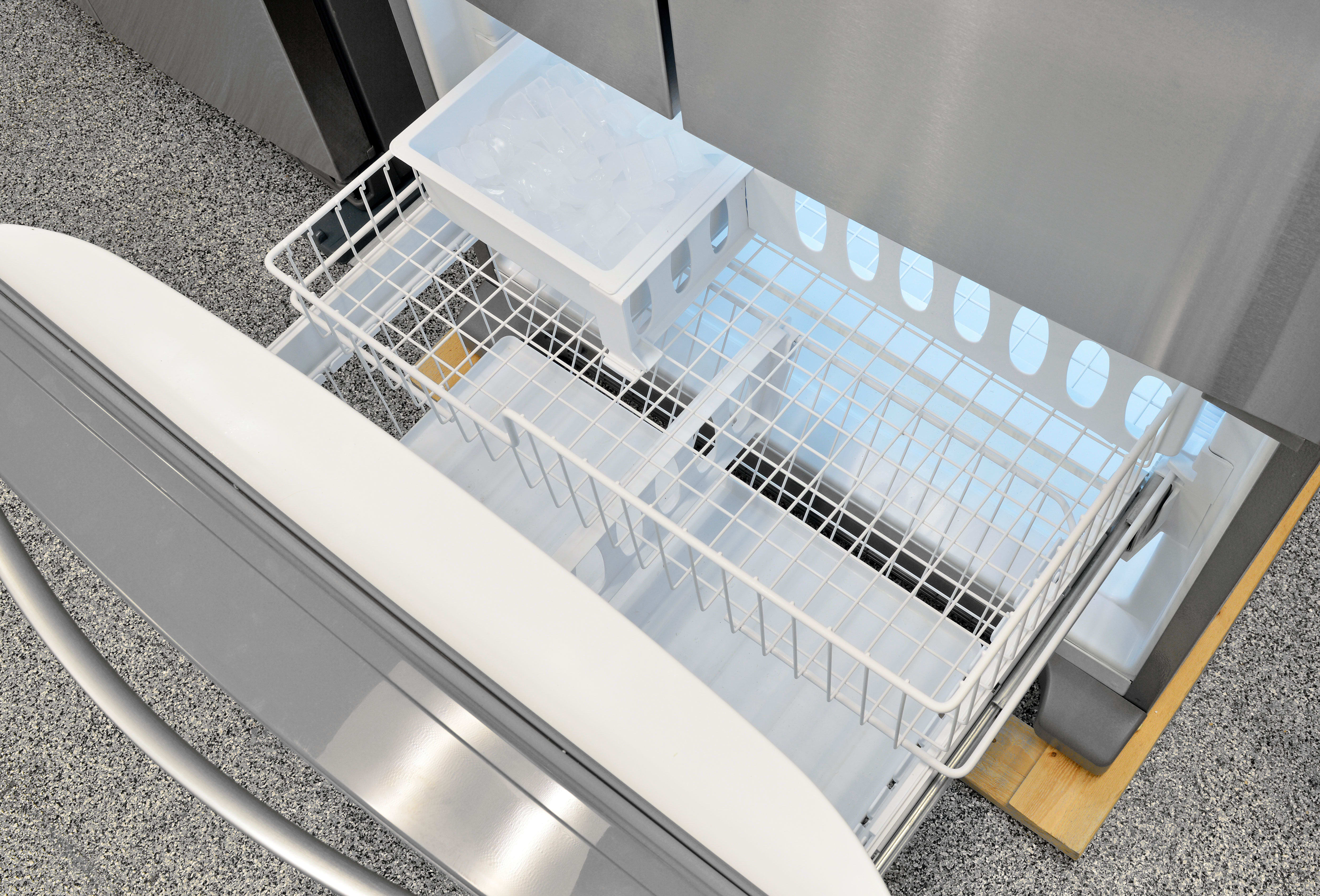 The Whirlpool WRF535SMBM's wire drawer in the freezer is one of the few visual elements in this model indicative of its lower price.