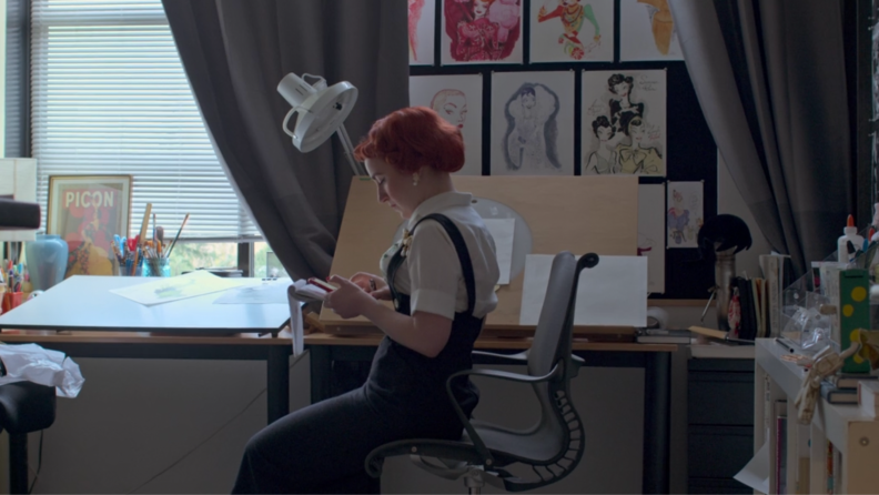 A still from the series Inside Pixar featuring one of the artists at her desk.