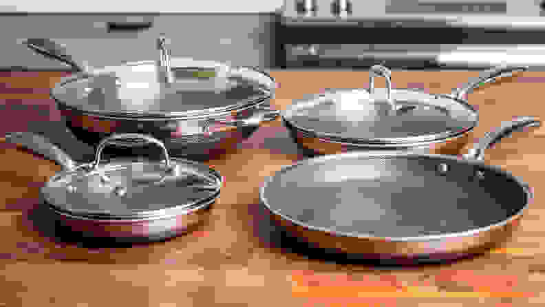 HexClad pots and pans sit on a kitchen counter.