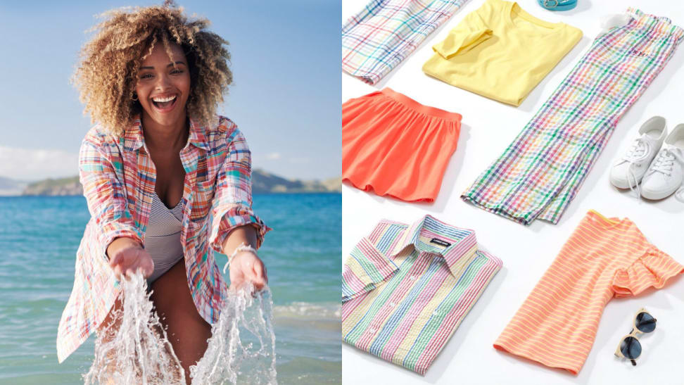 Woman splashing water next to colorful clothes