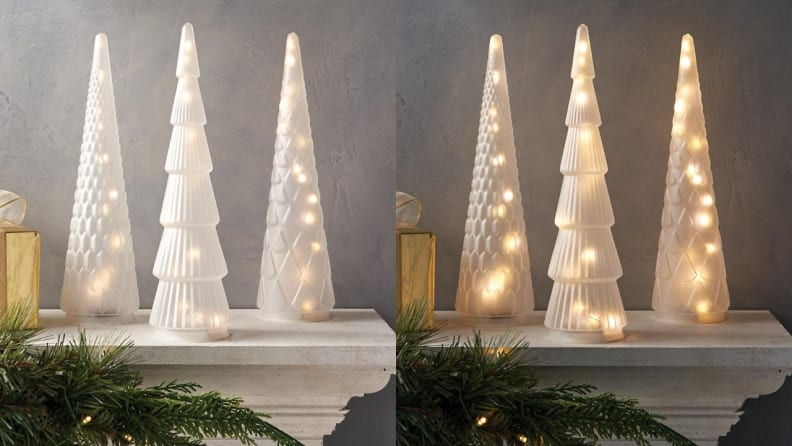 The frosted glass trees automatically light up for six hours at night.
