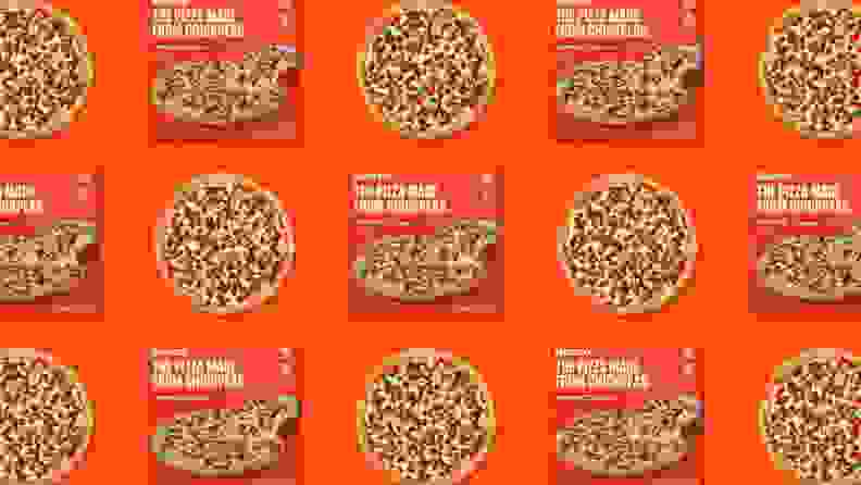A pattern of frozen pizza boxes and frozen pizzas on an orange background.