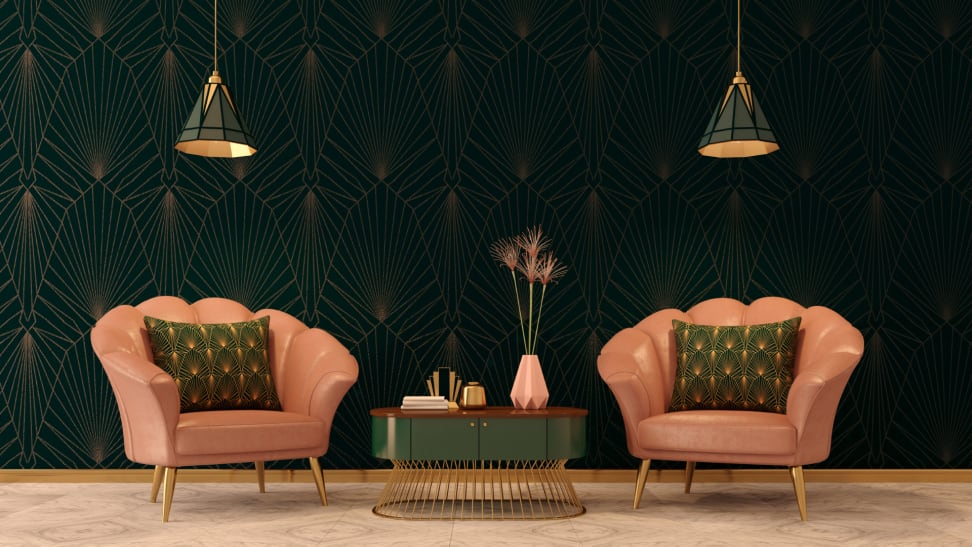 An Art Deco inspired sitting room with two pink armchairs and green accent table.