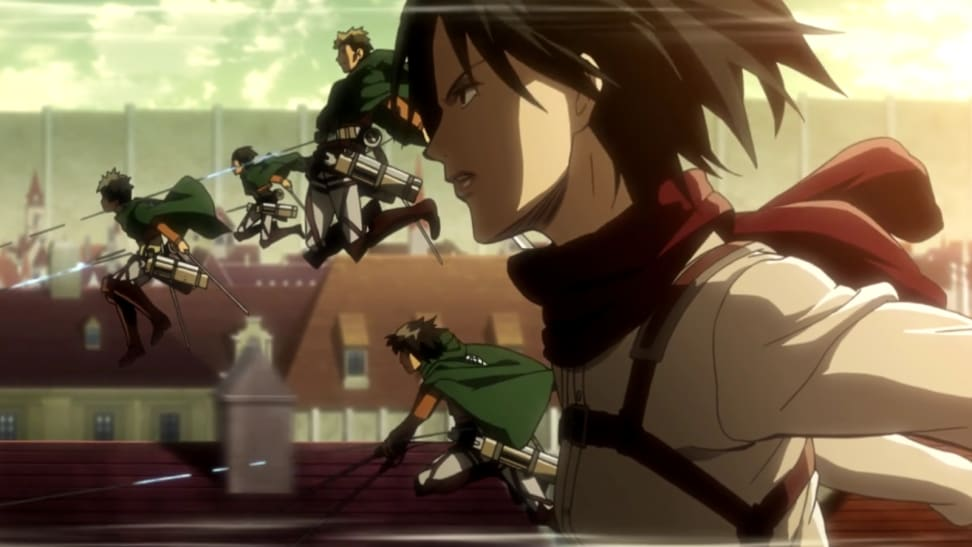 A still from Attack on Titan featuring Mikasa in her gear with the rest of her team.