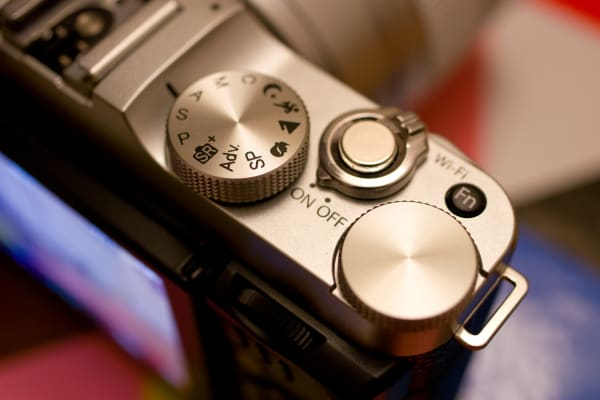 Instead of a shutter speed dial, the X-A2 has a more standard mode dial with a second control wheel.