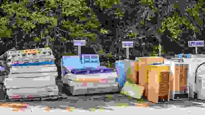 stacks of different materials sit outside ready to be recycled