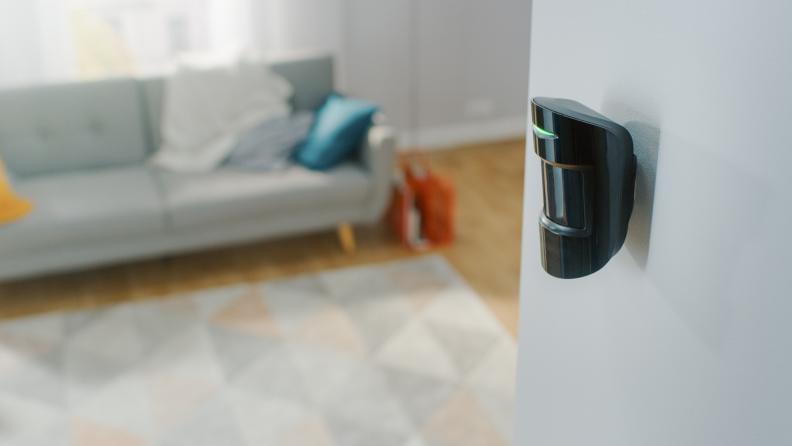 Motion sensor mounted to living room wall.