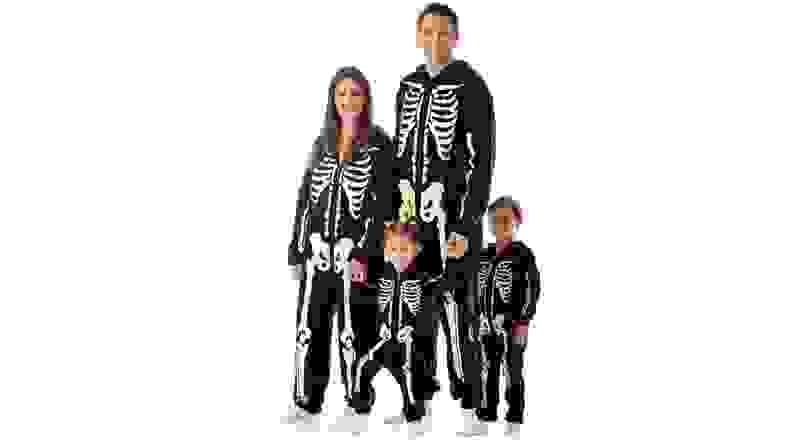 A family in glow-in the dark skeleton onesies.