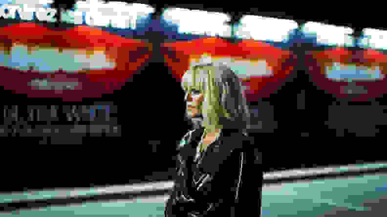 Vanessa Paradis walks in a street, in a scene from