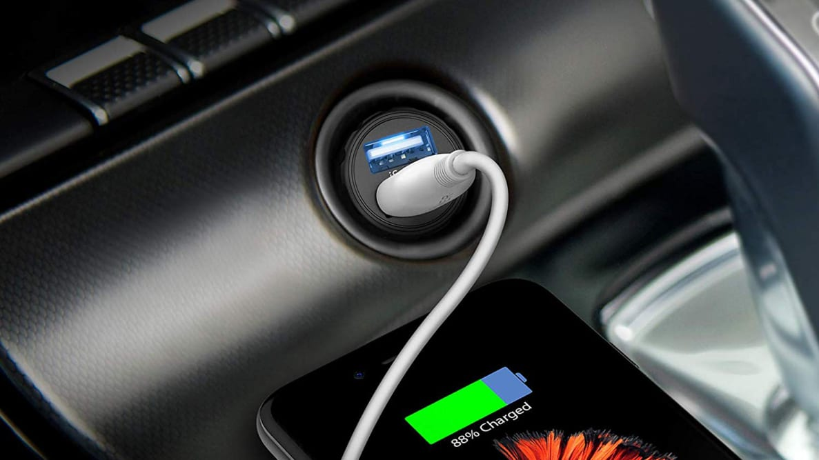 A car usb charger made by Anker charging an iPhone