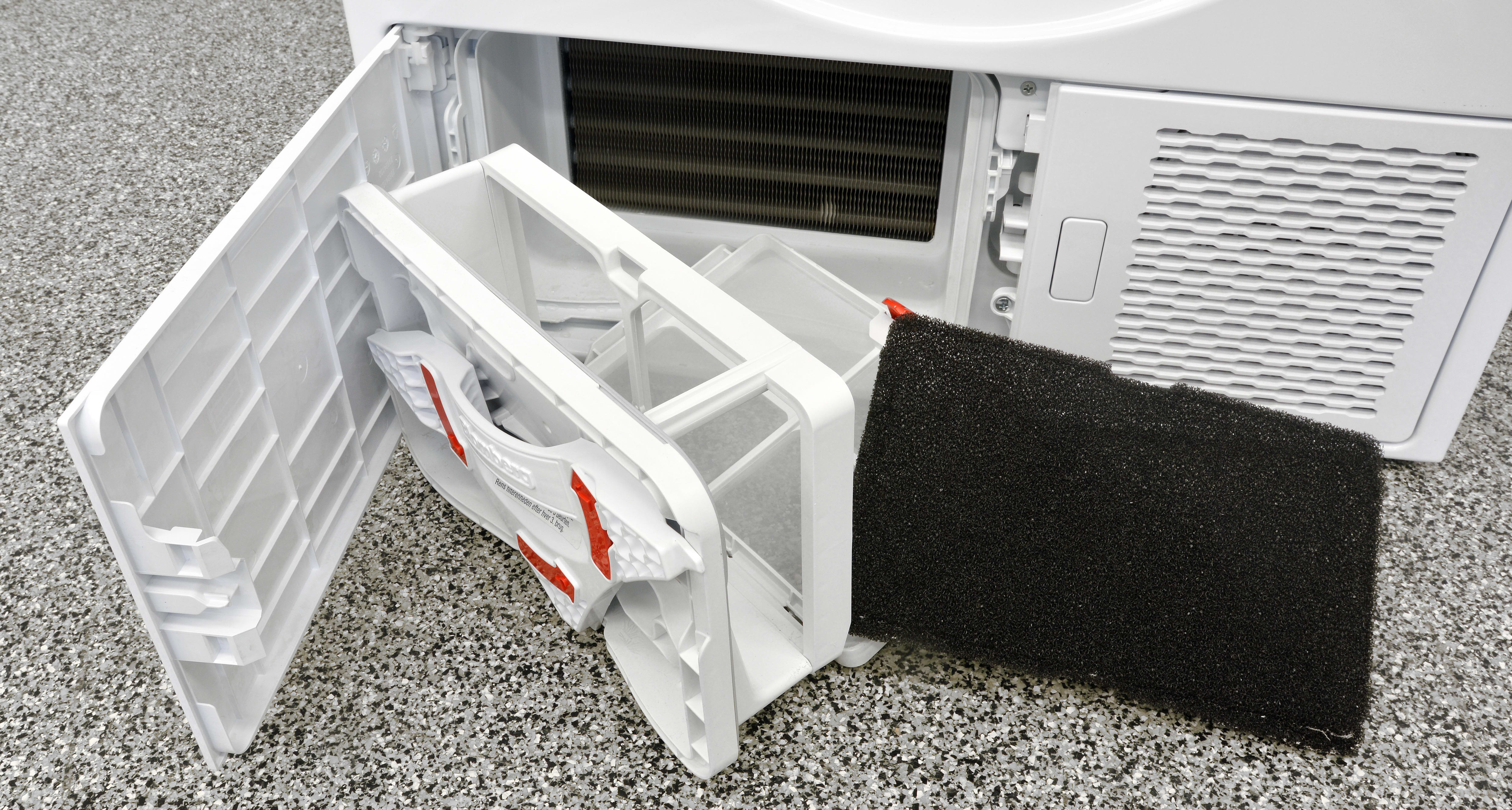 To clean, release the red clasp on top, take out the black pad, and remove any lint from the Blomberg DHP24412W.