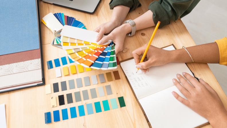 A client and a designer pick a color palette for a design.