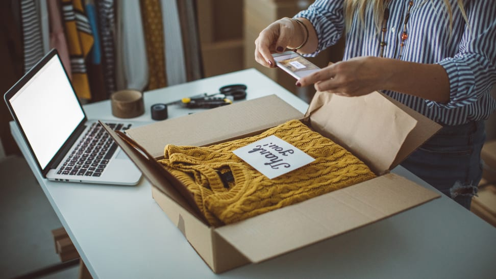 Woman shipping a sweater she sold online