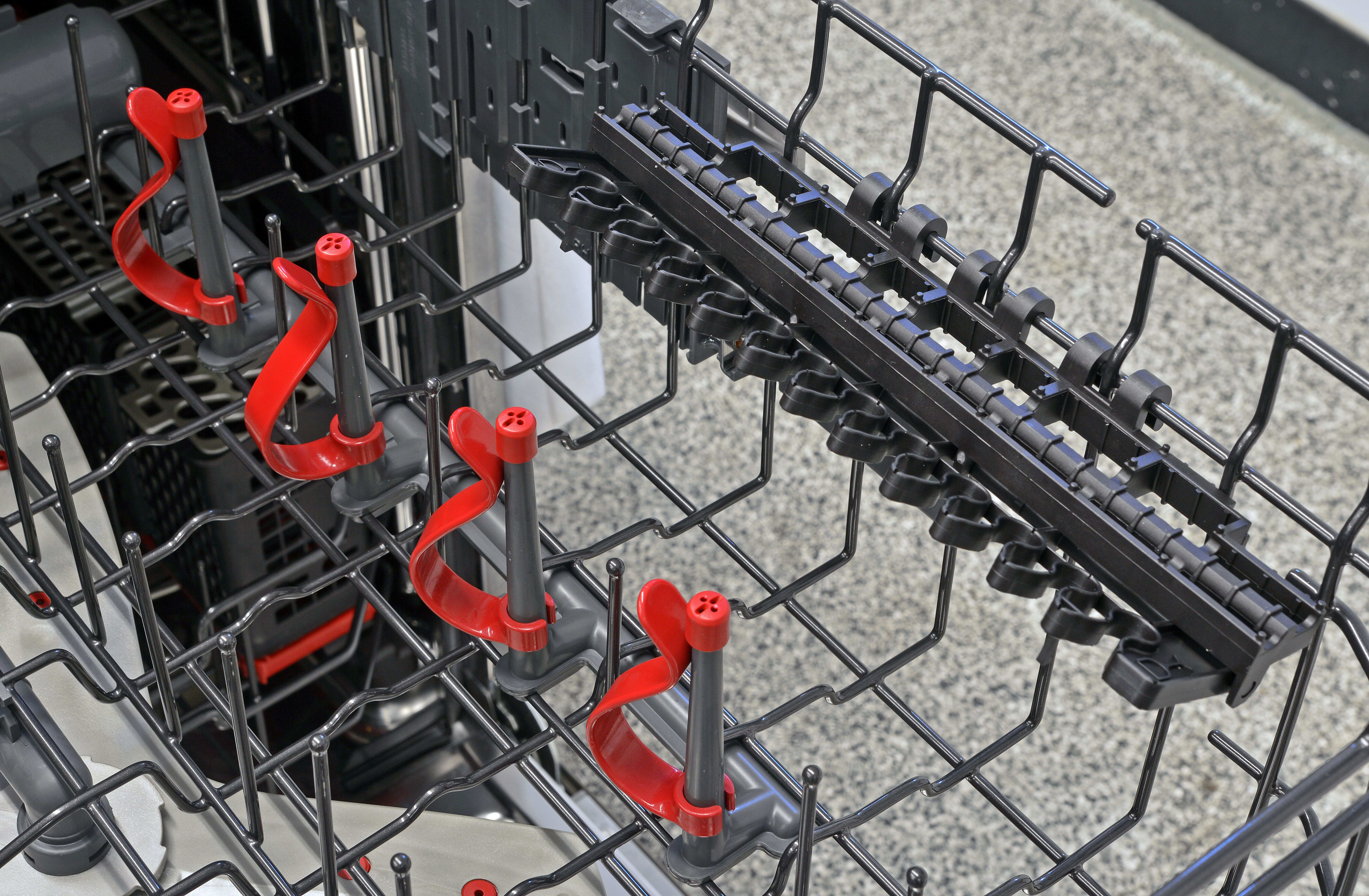 The GE Profile PDT855S's upper rack features four bottle jets, as well as two racks of stemware clips.