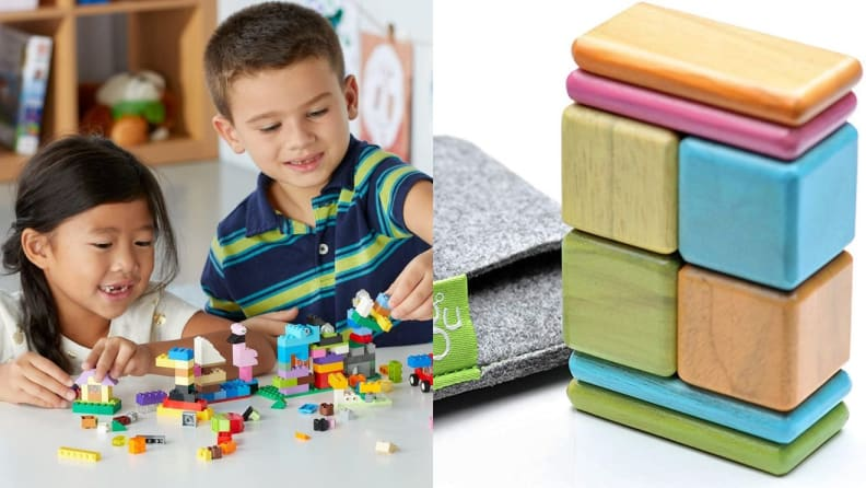 Two children smiling while playing with Lego blocks. On right, multi-colored children's blocks stacked together.
